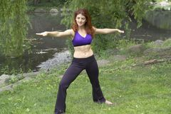 Girl exercising in park. Girl exercising in Central Park New York.  She was 26 at the time of shoot and Jewish American.  Photographed June, 2007 in the USA Royalty Free Stock Image