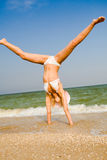 Girl exercising at sea beach Royalty Free Stock Image