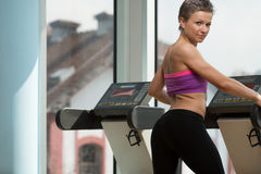 Girl Exercising On Step Machine In Fitness Club Royalty Free Stock Photography