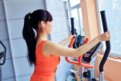 Girl exercising at the  on stepper machine Stock Photography