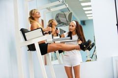 Girl exercising on VKR Stock Photography