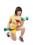 Girl exercising with weights Stock Images