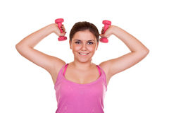 Girl exercising with weights Stock Photo