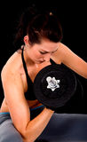 Girl exercising with weights Royalty Free Stock Images