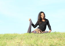 Girl exercising yoga - One-Legged King Pigeon Stock Photo