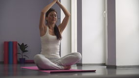 Girl exercising yoga, taking a prayer position