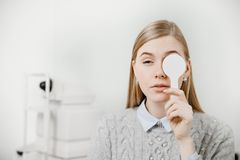 Girl experiences eye problems reception doctor ophthalmologist. Young girl experiences eye problems reception doctor ophthalmologist stock photos