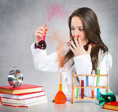 Girl experimenting with chemical liquids Royalty Free Stock Image