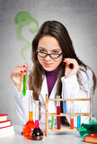 Girl experimenting with chemical liquids Stock Photo