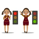 Girl explain pedestrian traffic light. Green red. Pedestrian traffic light. Girl shows and explains the rules of road safety. Red and green light. Attention on Royalty Free Stock Image