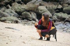 Girl explores beach Stock Image