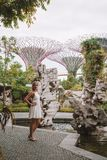 Girl Exploring Gardens by the Bay in Singapore. SINGAPORE ASIA - MAY 9: Beautiful girl exploring Gardens by the Bay with an amazing view on the Supertree Grove Stock Images