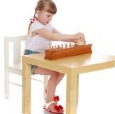 Girl exploring Montessori materials Stock Image