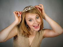 Girl expresses emotions of joy with crown Royalty Free Stock Images