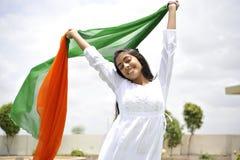 Girl expressing freedom. Indian girl celebrating indian independence day Royalty Free Stock Photo
