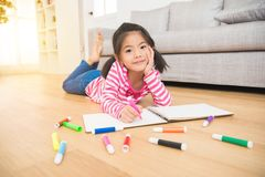Girl expressive her drawing skill on sketchbook Royalty Free Stock Photos