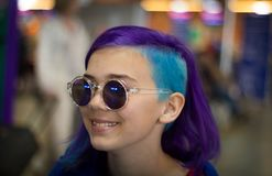 Girl with extreme hair. In sunglasses stock images
