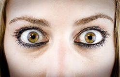 Girl eye. Close up of the eyes of a pretty young girl in a surprise or fear expression royalty free stock images