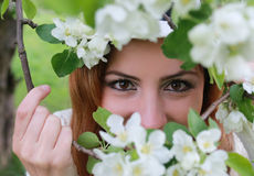 Girl eye behind tree flower Stock Photo