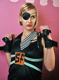 Fighting girl with eye patch Stock Photo