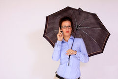 Girl with eyeglasses holding the umbrella Royalty Free Stock Photography