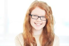Girl in eyeglasses Stock Image
