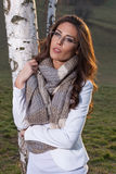 Girl with eyeglasses and wooll scarf Stock Images