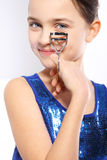 Girl with eyelash curler for overclocking Royalty Free Stock Photo