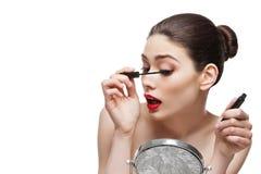 Girl with eyelash mascara Stock Images
