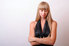 Girl with eyes closed. In a black dress Royalty Free Stock Image