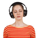 Girl with eyes closed listening to music Royalty Free Stock Images