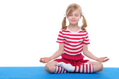 Girl with eyes closed practicing yoga royalty free stock photos
