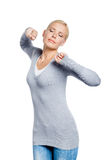 Girl with eyes closed stretches herself Royalty Free Stock Photo