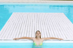 Girl With Eyes Closed Sunbathing At Poolside Royalty Free Stock Image