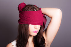 Girl with eyes covered. Portrait of a girl with eyes covered stock photo