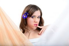 The girl with fabric and a flower of an iris Royalty Free Stock Photos