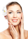 Girl face. Closeup beautiful woman face with flower isolated on white background Royalty Free Stock Image