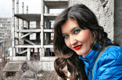 Girl face against a neglected building Stock Photo