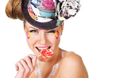 Girl with face-art holding lollipop Royalty Free Stock Image