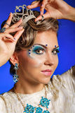 Girl with face art, jewelry, hair and tiara. Stock Photos