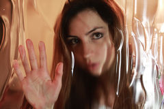 Girl face behind glass Royalty Free Stock Image
