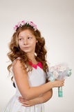 The girl face close up with a bouquet. Beautiful woman inhales the fragrance of flowers. The girl face close up with a bouquet Royalty Free Stock Photos