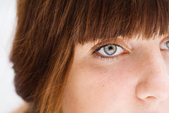 Girl face close-up with hair. Young pretty girl face with freckles close-up Stock Photos