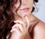 Girl face with curl hair Stock Photos