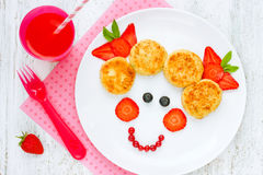 Girl face dessert or breakfast for of kids - cheese pancakes wit Royalty Free Stock Photo