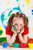 Girl with face and hands painted Royalty Free Stock Photos