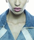 Girl face and lips with jeans jacket. Girl face and lips wearing jeans jacket Royalty Free Stock Photo