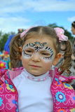 Girl with face paining. Cute Little girl with face painting Stock Photos