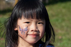 Girl Face paint. Young girl that had her face painted at a festival stock image
