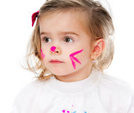 Girl with face in paint. Cute little girl with face in paint royalty free stock images